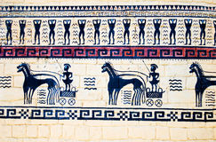 Wall-painting with Greek warriors on chariots with Stock Photo