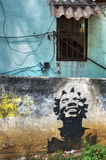 Wall painting in Havana, Cuba. A colourful wall painting in Havana, black woman looking up at the window stock photography
