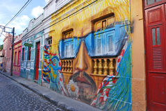 A wall painting of a man's head with moustache and sunglasses. OLINDA, RECIFE, PERNAMBUCO, BRAZIL, JANUARY 8 2008. A wall full of illegal graffiti. A wall Royalty Free Stock Photography