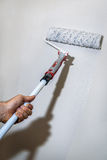 Wall painting with a paint roller Royalty Free Stock Photo