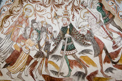 Wall painting from the 1400s in a Danish church. St. Lawrence shows up the poor befor the emperor and is whipped, Over Dråby church, Denmark, Nov 14, 2016 Stock Photography