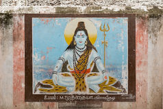 Wall painting shows sitting Lord Shiva. Royalty Free Stock Images