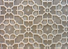 Wall panel in brown tones with a three-dimensional ornament. The element of decor royalty free stock photography