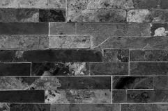 Grunge dark grey or black stone wall tiles texture. Wall natural black stone dirty,dust with pattern design or abstract background Royalty Free Stock Image