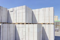 Autoclaved aerated concrete wall panels on an outdoor warehouse. Wall panels made of the autoclaved aerated concrete on wooden pallets put one on the other on an stock photography