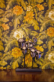 Wall paper and adornment. Wallpaper background, a like mask adornment  on the table Stock Photo