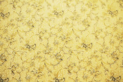 Wall paper with flower pattern. Golden and brown wall paper with flower pattern royalty free stock image