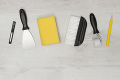 Wall Paper Home Improvement Tools on Wooden Surface Copy Space Royalty Free Stock Photography