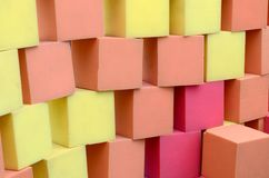 Wall of paralon soft cubes in dry pool, trampoline in the childrens center. Wall of yellow and red paralon soft cubes in dry pool, trampoline in the childrens royalty free stock photos