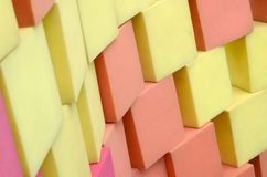 Wall of paralon soft cubes in dry pool, trampoline in the childrens center. Wall of yellow and red paralon soft cubes in dry pool, trampoline in the childrens stock image