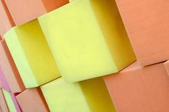 Wall of paralon soft cubes in dry pool, trampoline in the childrens center. Wall of yellow and red paralon soft cubes in dry pool, trampoline in the childrens stock photos