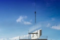 A wall part of a prefabricated house on a crane Royalty Free Stock Photo