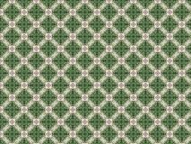 Wall with a pattern of plaster decorated with green leaves royalty free stock photography
