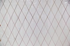 Wall with a pattern from a rhombus. Brilliant background in the form of a wall with a pattern from a rhombus Stock Photo