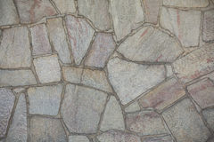 Wall paved with natural stones Stock Photography