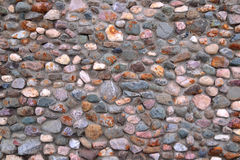 Wall of pebbles and cement background Royalty Free Stock Photos
