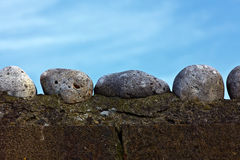 Wall and large pebbles Stock Photo