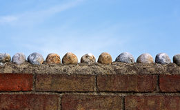 Large  pebbles on a wall Royalty Free Stock Photos