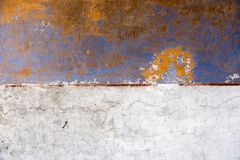 Wall with peeling paint. Of different colors Stock Photo