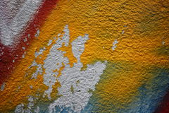 Wall with peeling plaster and graffiti 5. Close up view of a wall with peeling plaster and graffiti royalty free stock image