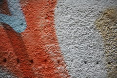Wall with peeling plaster and graffiti 7. Close up view of a wall with peeling plaster and colorful graffiti Stock Image