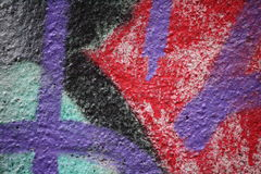 Wall with peeling plaster and graffiti 9. Close up view of a wall with peeling plaster and colorful graffiti royalty free stock photography