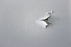 Wall with peeling white paint Royalty Free Stock Image