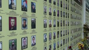 Wall with photos soldiers who died in the Russian-Ukrainian war. Photo people killed during the Maidan revolts. Memorial