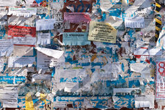 Wall with pieces of old ads Stock Images