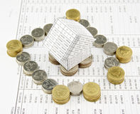 Wall of pile gold and silver coins around house Stock Photography