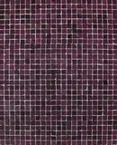 Wall with pink purple mosaic tiles Royalty Free Stock Images