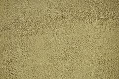 Wall plaster covered by yellow rough paint. Close-up of wall plaster covered by yellow rough paint, forming a singular background at Belmonte. A cute small town stock photography