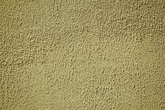 Wall plaster covered by yellow rough paint. Close-up of wall plaster covered by yellow rough paint, forming a singular background at Belmonte. A cute small town royalty free stock image