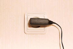 Wall plug with a cable Royalty Free Stock Photo