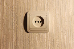 Wall plug with a sharp shade Royalty Free Stock Photo