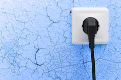 Wall plug socket on cracked wall Stock Photo