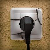 Wall plug socket on cracked wall Royalty Free Stock Photos