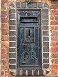 Wall post box of George V in Hagley, Worcestershire. Wall post box of George V by W.T. Allen & Co. Ltd. of London, Hagley, Worcestershire, England, UK Stock Image