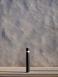 Wall, post, pavement. stock photography
