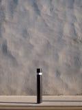 Wall, post, pavement. Stock Photography