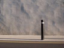 Wall, post, pavement. Stock Photos