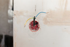 Wall power socket, plastic electrical junction box with electric wires Royalty Free Stock Images