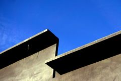 A wall of prefabricated concrete against a blue sky with open space - Image stock image