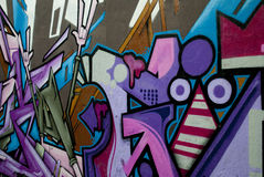 Wall with purple graffiti Royalty Free Stock Image