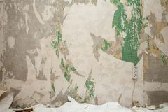 Wall with ragged wallpapers Stock Photos