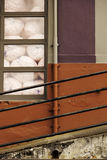 Wall and Railing. Bold wall with packing material in the window and railing along the ramp Royalty Free Stock Image