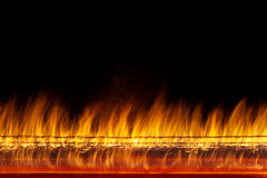 Wall of real fire flames  on black background Royalty Free Stock Photography