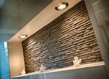 Wall recess in a bathroom. Made of sandstone tiles Stock Image