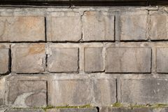 A wall of rectangular cement blocks on a Sunny day. Backgrounds texture design stock image