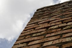 A wall of red brick against the sky. Down up. Textured background royalty free stock images
